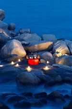Preview iPhone wallpaper Stones, sea, coast, table, candle, dinner, romantic