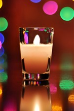 Preview iPhone wallpaper Glass cup, candle, flame, colorful light circles
