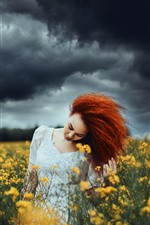 Preview iPhone wallpaper Red hair girl, hairstyle, yellow rapeseed flowers, clouds