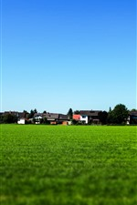Preview iPhone wallpaper Village, countryside, green field, houses, blue sky