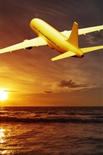 Aperçu iPhone fond d'écranAvion, mer, coucher de soleil, nuages, vol, ciel
