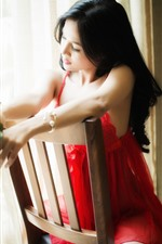 Preview iPhone wallpaper Red skirt Chinese girl sit on chair, rose