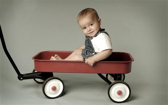 Wallpaper Cute baby sitting in a trolley
