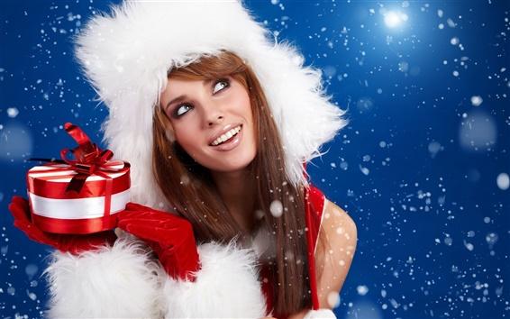 Wallpaper Christmas girl holding a Christmas gift
