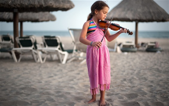 Wallpaper Cute little girl at the beach playing a violin