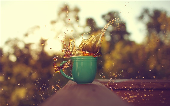 Wallpaper A cup of coffee, drops splash, blurred background