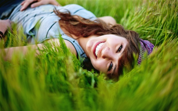 Wallpaper Smile girl in the grass