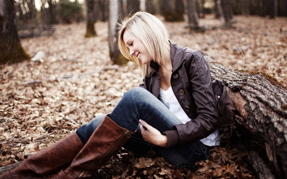 Wallpaper Smile girl sit on forest ground