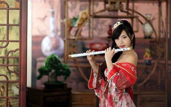 Обои Красное платье девушка, играть на флейте