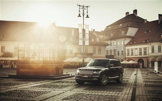 Обои Land Rover черный внедорожник автомобиль, дом, солнце