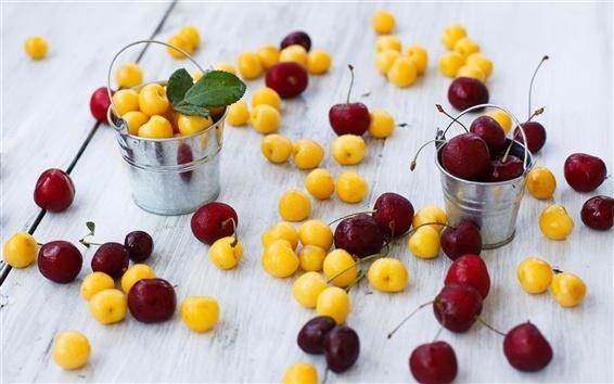 Fond d'écran cerises jaunes et rouges, de petits seaux