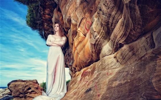Wallpaper White dress girl standing at rock side