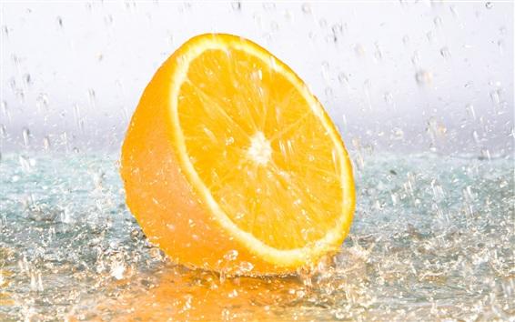 Wallpaper A half orange in rain