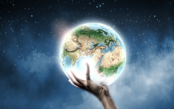 Wallpaper Creative pictures, a hand hold the Earth