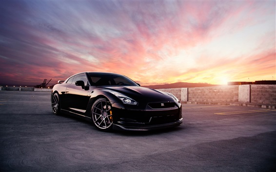 Обои Nissan GT-R черный автомобиль на закате