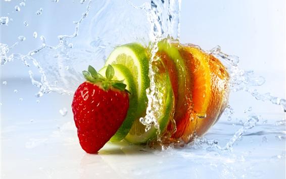 Wallpaper Fruit slices, strawberry, lime, orange, water splash