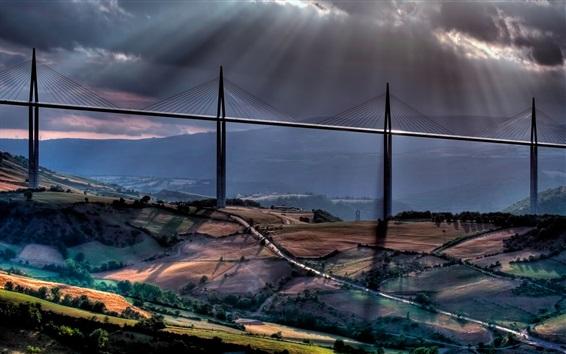 Wallpaper Sun rays, clouds, road, mountains, viaduct, bridge, Millau, France