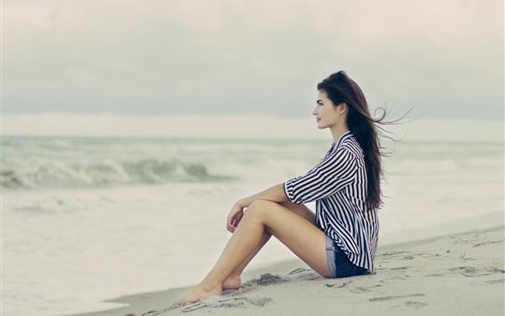Wallpaper Brunette hair girl sitting at the beach, sea, wind