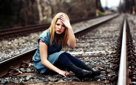 Wallpaper Blonde girl sit at railroad