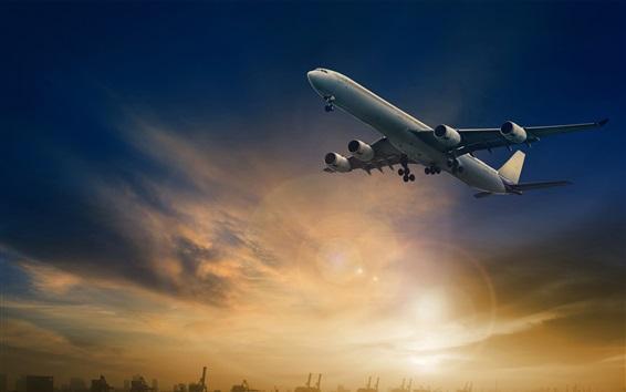 Fond d'écran Vol d'avion de passagers dans le ciel, le crépuscule, les rayons du soleil
