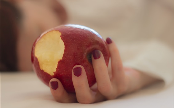 Wallpaper A red apple in hand
