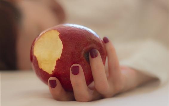 배경 화면 손에 빨간 사과