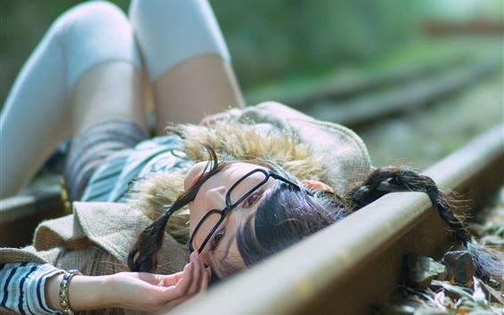 Wallpaper Asian girl lying on railway side, glasses
