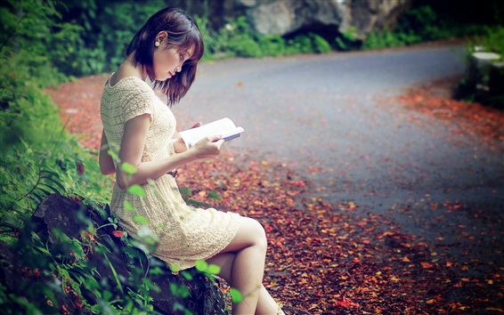 Wallpaper Asian girl reading book, road, leaves