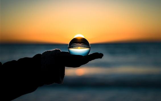 Обои Стеклянный шар в руке, закат, вечер