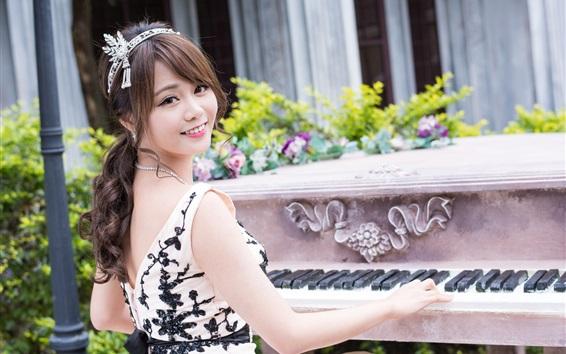 Wallpaper Happy Asian girl play piano