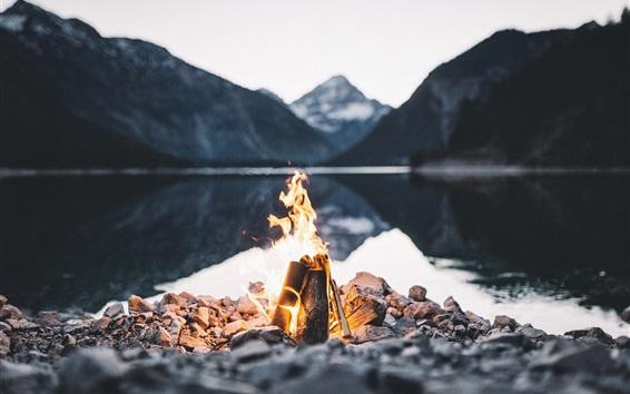 Wallpaper Fire, flame, stones, lake, dusk