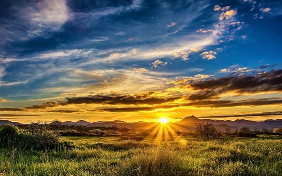 Wallpaper Grass, sunset, mountains, clouds, sun rays