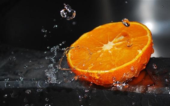 Обои Половина апельсина, всплеск воды