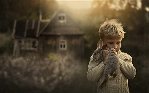 배경 화면 귀여운 작은 소년과 토끼