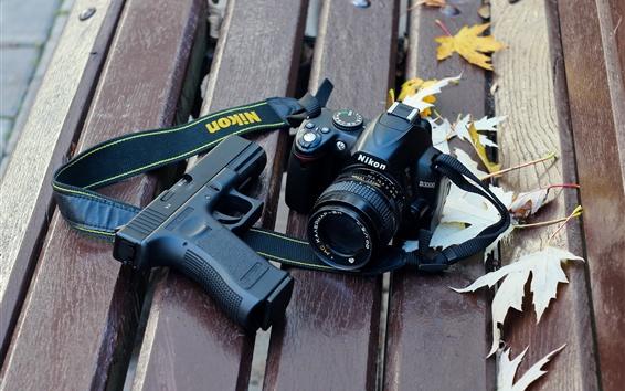 Обои Цифровая камера Nikon D3000 и пушка