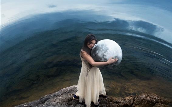Fond d'écran Fille embrasse un modèle de la terre