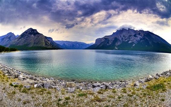 Wallpaper Rocky mountain, lake, stones, sky, clouds, dusk