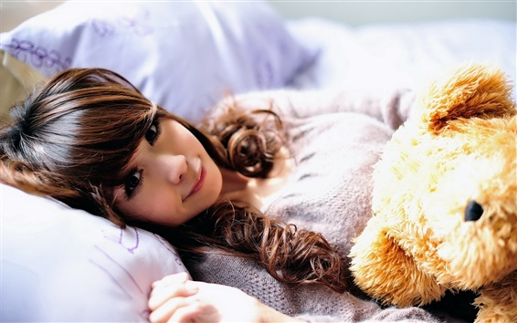 Wallpaper Asian girl and bear toy in bed