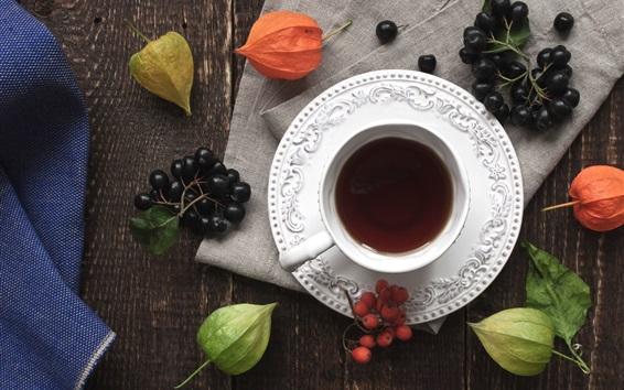 Fond d'écran Une tasse de thé, des baies