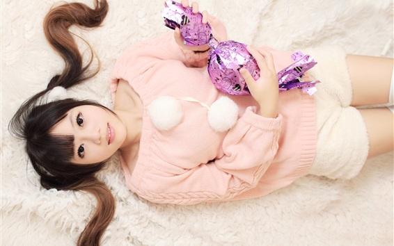 Fond d'écran Pull rose Asiat, lit, gros bonbon