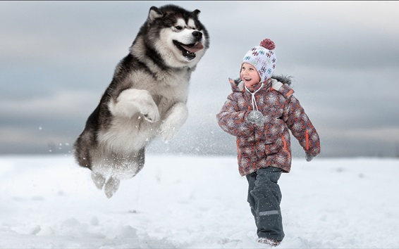Wallpaper Child girl and dog play in the snow