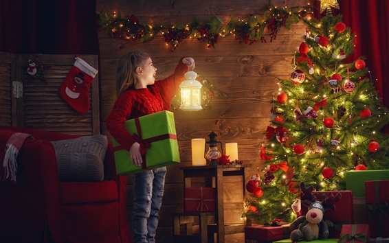 Wallpaper Happy child girl look at Christmas tree, lamp, holiday lights, gift, room