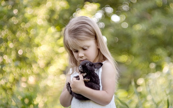Wallpaper Blonde child girl and her pet black rabbit