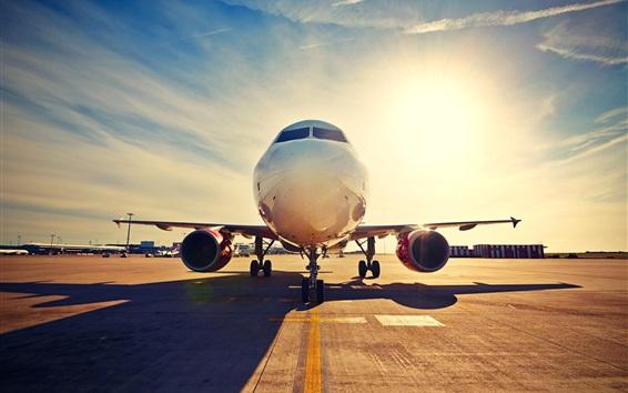Wallpaper Passenger plane, front view, airport, runway, sunset