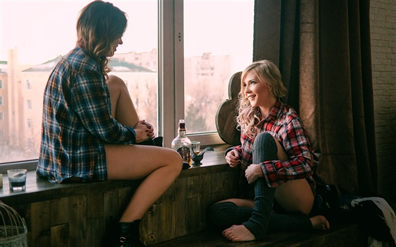 Wallpaper Two girls sit on windowsill