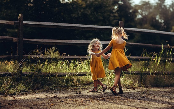 Wallpaper Two little girls, happy dance, grass, fence, summer
