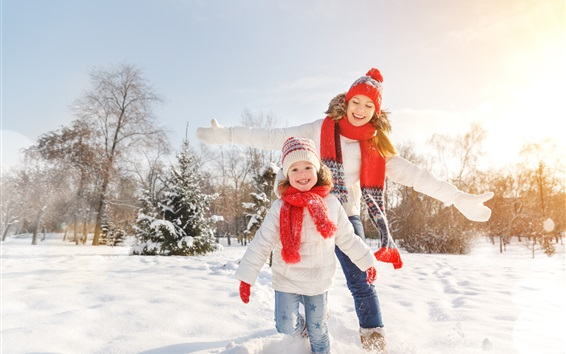 Wallpaper Happy little girl and her mom, snow, winter