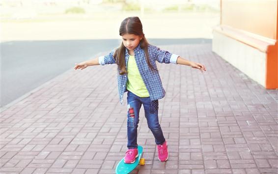Wallpaper Cute little girl use skateboard