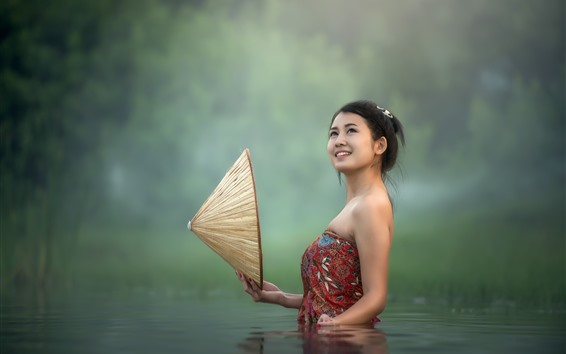 Wallpaper Asian girl standing in pond water