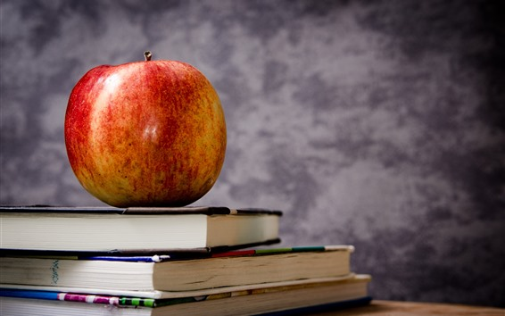Wallpaper One red apple and books, still life